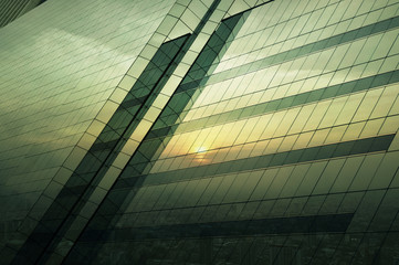 Fototapete - Reflect of aerial view of cityscape at sunset on window glass to