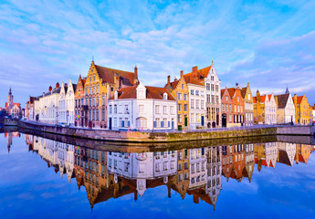 Wall Murals Bridges Cityscape view of Bruges and traditional houses reflected in water at sunrise in Belgium