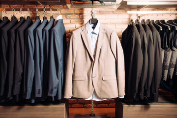 Many men's business suits of different colors