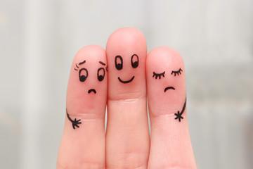 Finger art. Happy man embraces two women, they do not like it.