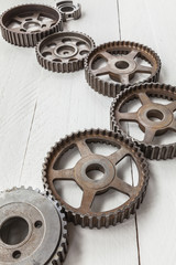 Cogwheels machinery , engineering and industry or concepts such as teamwork and search engine on white background