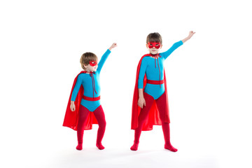 Two children playing in a superhero isolated.