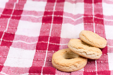 Round tea cookies on the kitchen tablecloth