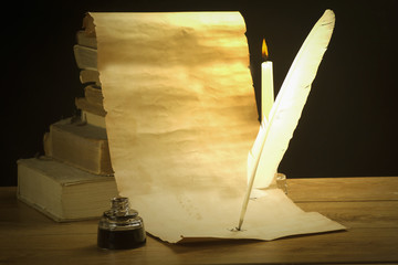 Developed parchment, pen, book and candle