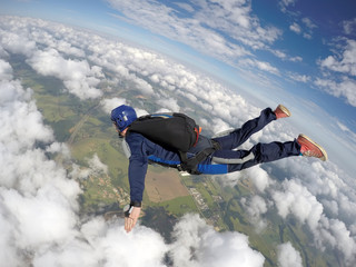 Skydiving starting a diving motion