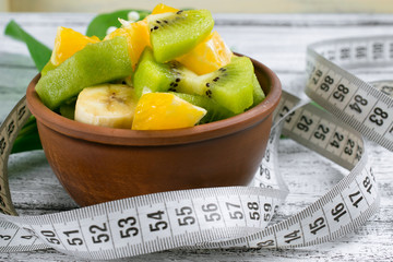 Fruit salad with kiwi, banana and orange for slimming and centim