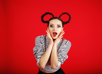 High fashion girl with unusual hairstyle like Minnie Mouse in the studio
