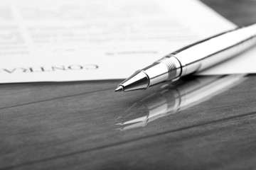signing a contract, business contract details. Black and white f
