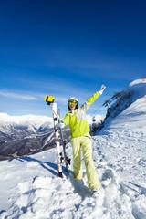 Young girl taking selfie photograph on ski resort