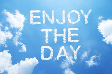 """enjoy the day"" clouds word."