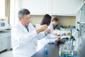 people doing chemical experiment in modern lab