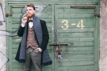 Gentleman smoking a cigarette in the street