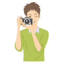 カメラ 男性 構える