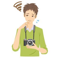 カメラ 男性 悩む