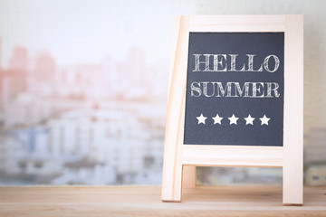 Concept HELLO SUMMER message on wood boards