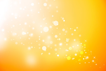 Gold glitter sparkles defocused rays lights bokeh abstract christmas background.