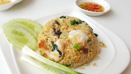Shrimp fried rice serving with onion and cucumber slice