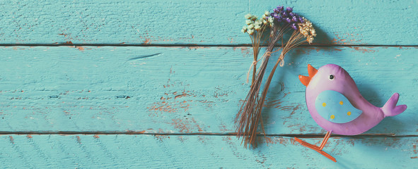 website banner background of dried colorful flowers on old blue wooden background
