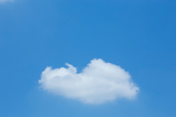 single cloud on clear blue sky with copy space for create text