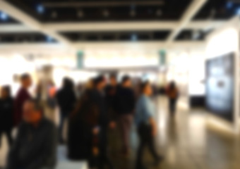 blur background of people at art gallery