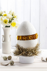 White ceramic egg with dried flowers - Easter decoration