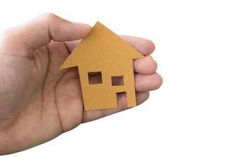 Hand holding house isolated on white background