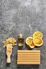 Spa set: sea salt, essential oil, bar of soap and dried oranges