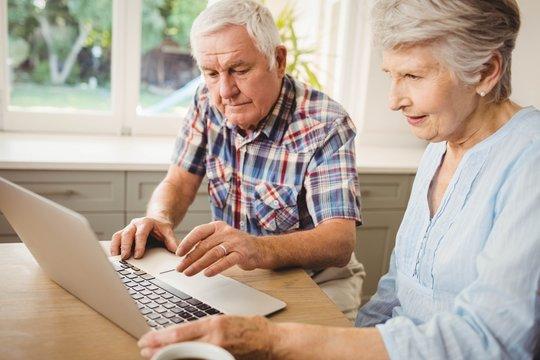 Senior couple checking their bills