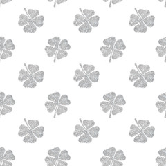 Seamless pattern of abstract four-leaf clovers of silver glitter