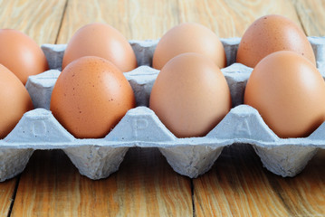 Side view of an eggs on a paper tray