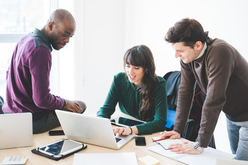 Multiracial contemporary business people working connected with