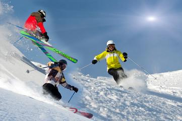 Skicollage, drei Skifahrer