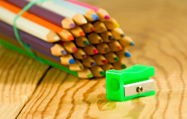 image of many pencils on the wooden table