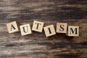 concept of autism word on wooden cubes
