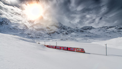 Swiss mountain train Bernina Express crossed through the high mo