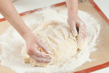 Making dough by hands at bakery
