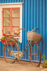 Old rusty lady bicycle in front of a Swedish house