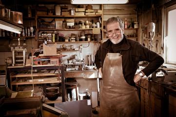 Portrait Master goldsmith working in his workshop