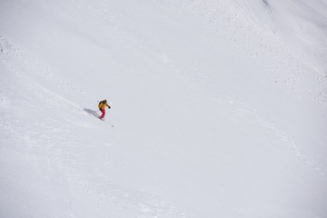 freeride skier skiing in deep powder snow