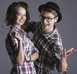 Happy smiling hipster students in the studio