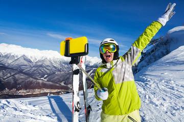 Happy screaming woman taking selfie on mountain