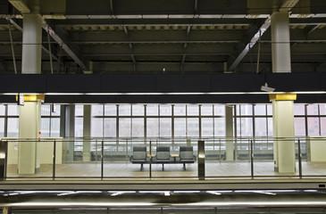 Wait chair on the train station platform.