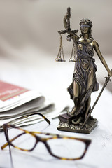 Law concept, statue, gavel, newspaper and glasses