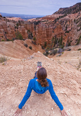woman enjoys view of bryce canyon landscape in Utah