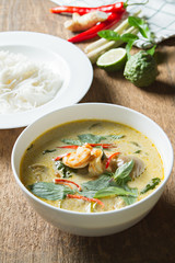 Green curry with shrimp and rice noodles. Thai cuisine. (kang keaw wan) Selective focus.