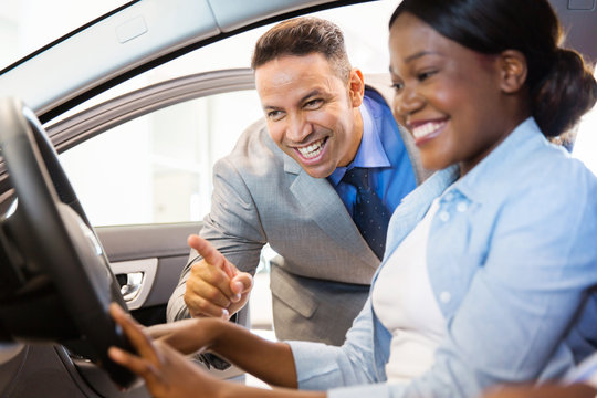 african american woman buying a car