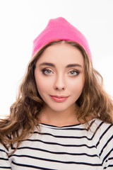 Portrait of beautiful young woman in pink hat and curly hair