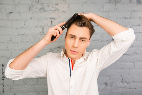 Handsome Pretty Young Man Combing His Hair Stock Photo And