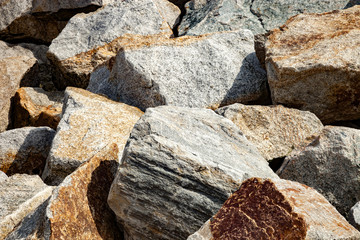 Closeup of huge rocks dam sea coastline port.
