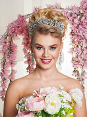 beautiful blonde bride with flowers